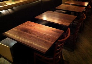 Custom made solid wood Black Walnut table tops at Chicago restaurant from Spiritcraft Design Furniture in Dundee, Illinois.