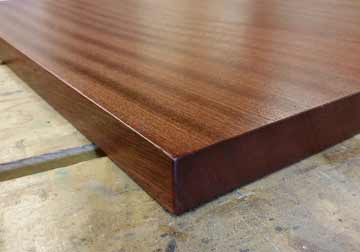 Custom made solid hardwood table tops for restaurant, office, library and residential clients in Sapele, Mahogany and other fine hardwoods