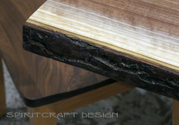 Live edge Dining table or desk in solid book-matched Black Walnut live edge slabs on solid Cherry trapezoid legs, displayed with RH Yoder chair at our retail furniture store in Chicago area, East Dundee, Illinois