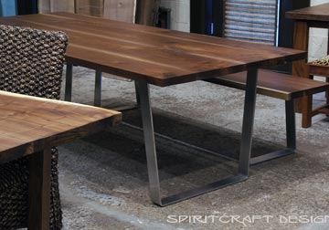 Dining table and matching bench from slabs of kiln dried Black Walnut with mid century modern style stainless steel trapezoid legs, solid hardwood tables at Spiritcraft Design Furnitue in East Dundee, Illinois.